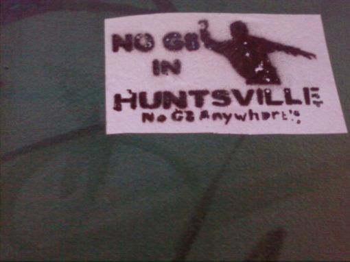 """NO G8 IN HUNTSVILLE"" and ""No G8 Anywhere"" below in smaller letters."